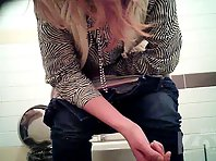 Wc2301# Blonde in gray panties pee standing up. Great pictures with the front camera. Beautiful ha