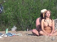 Nu1352# Nude beach voyeur camera continues to monitor the couple. Man stroking his girlfriend and
