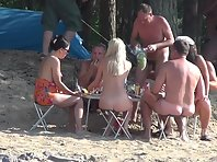 Nu1390# Nude beach voyeur cam continues to monitor the bare meal. Nudists eat meat, but I think th