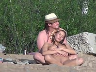 Nu1354# Our couple begins to dress and nude beach voyeur camera switches to their neighbors. There
