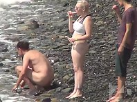 Nu2214# There are several new visitors on the beach. The blonde took off her panties, but did not ta