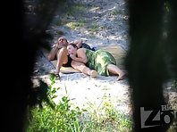 Nu1957# Another couple sunbathing on the shore of the lake. The woman starts sucking her friend's co
