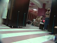 Lo1376# Locker room voyeur cam from afar watching a group of women changing the clothes. Their nak