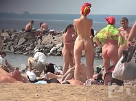 Nu1322# Nudists on the beach. Our nude beach voyeur cam quietly watching them. In the foreground i