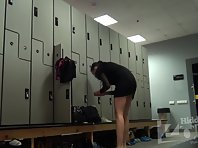 Lo1481# Hidden camera in the women's locker room in a fitness club. Slim tanned girl dresses up be