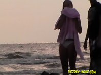 Nu1146# Two girls come out of the water, my camera follows closely behind them.