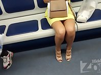 Up2814# A skirt of a slender girl in a yellow dress. Our cameraman filmed on her hidden camera her r