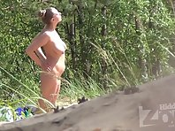Nu1653# In this video, Nude beach voyeur cam again filmed a woman with big tits. I admire the spec