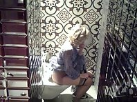 Wc2739# A woman in black panties pissed while sitting. View from one camera. In the toilet of the ca